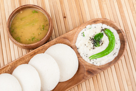 india food: A traditional ethnic south Indian breakfast of Idly (Idli  rice cake) served with coconut chutney and sambar.