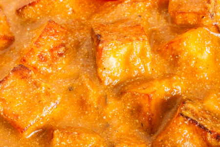 paneer: Indian Paneer Butter Masala Closeup - Closeup overhead view of delicious Indian paneer butter masala. It is prepared using paneer (cottage cheese), butter, tomato and various spices.