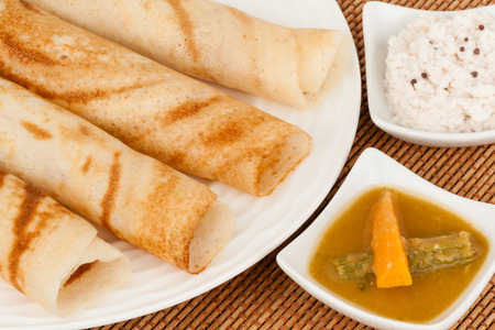chutney: Indian Dosa with Chutney Sambar  A traditional ethnic south Indian breakfast of Dosa Dosai served with coconut chutney and sambar. Stock Photo