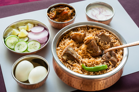 Mutton biryani with traditional sides