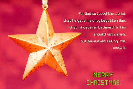 star shaped: Christmas Holy Bible verse John 3:16 - A star shaped Christmas ornament set against a maroon red background. Bible verse John 3:16 is displayed along with Merry Christmas message. Stock Photo