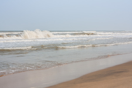frothy: Frothy waves on beach - Incoming high frothy sea waves on a tropical beach in the evening.