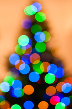 Colorful Christmas tree lights bokeh - A bright multicolor bokeh created by a set of de-focused lights on a Christmas tree.