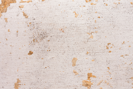 Chipped paint on old wall background - Old cement plastered wall that has chipped paint.