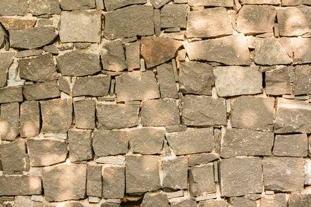 Grey stone wall background - Grey stone wall on grey mortar background.