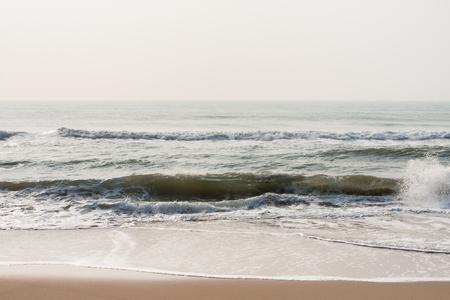 Calm waves on beach - Calm sea waves at morning time on a tropical beach.