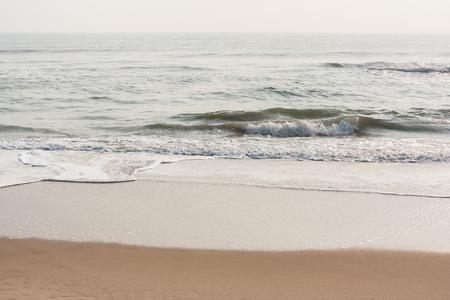 Foamy waves on calm beach - Foamy sea waves on a calm tropical beach in the morning.