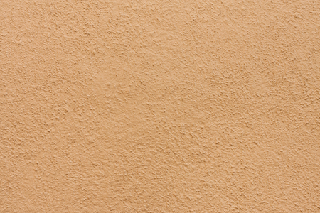 Stucco wall - Brown beige stucco textured wall background with natural light.