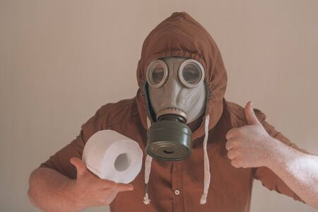 Man in a gas mask and toilet paper.