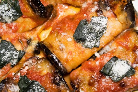 rolled slices of eggplant, stuffed with ham and cheese, served with tomato basil and grated Parmesan cheese and baked