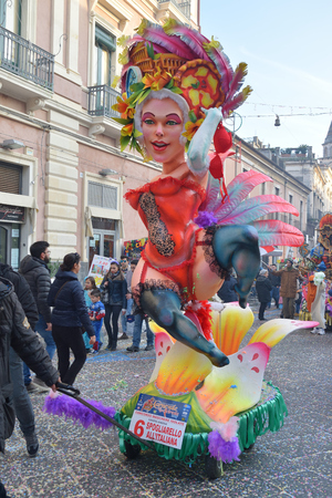 Acireale (CT), Italy - February 28, 2017: small allegorical float, depicting a burlesque dancer, during the carnival parade along the streets of Acireale.