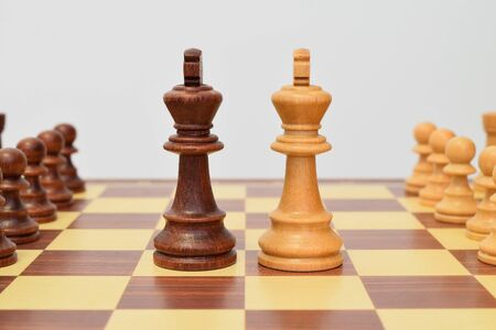 King at the center of the chessboard in a challenging attitude Stock Photo