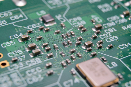 close up of electronic components on pcb board Stock Photo