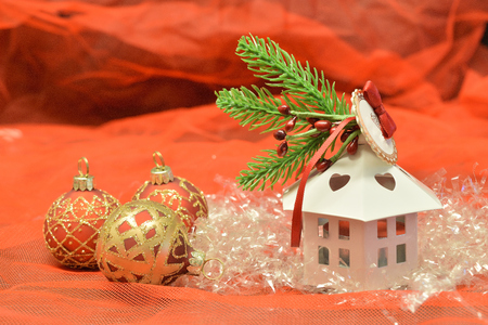 small white house shaped lantern on red background Reklamní fotografie