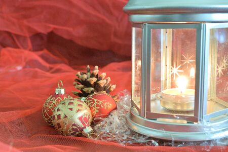 closeup of a composition of Christmas decorations on a red background