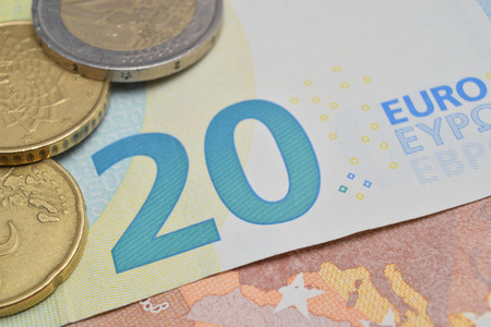 close up of various coins and euro banknotes