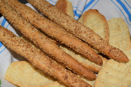 basket with bread and grissini with sesame Reklamní fotografie