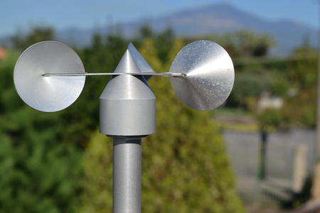 close up of aluminum anemometer on roof