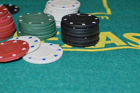 Stack of poker chips on a gambling table