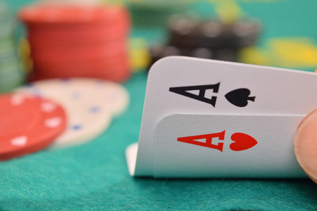 aces pair on a gambling table with chips