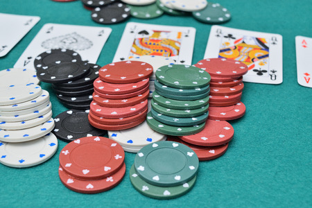 chips and cards on a gambling table with chips Stock Photo