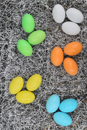 chocolate eggs of various colors with decorations