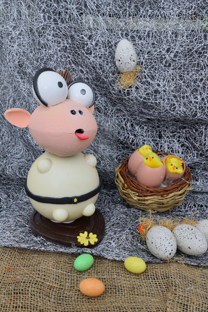 chocolate egg in the shape of a lamb with various decorations Reklamní fotografie