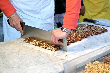 Stall with artisan preparing the traditional Sicilian torrone Reklamní fotografie