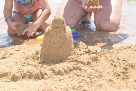 building a sand castle on the beach
