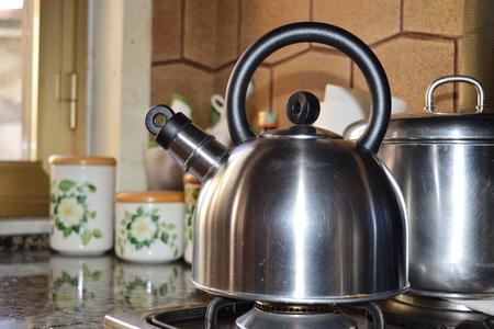 close up of a teapot on the stove Reklamní fotografie