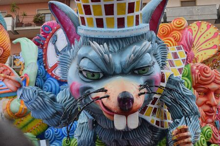 Acireale (CT), Italy - February 16, 2020: detail of a allegorical float depicting a mouse during the carnival parade along the streets of Acireale. Foto de archivo - 141805587