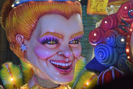 Acireale (CT), Italy - February 16, 2020: detail of a allegorical float depicting a womanÕs head during the carnival parade along the streets of Acireale.