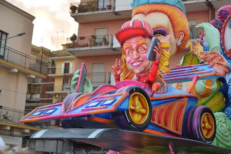 Acireale (CT), Italy - February 16, 2020: detail of a allegorical float depicting a race car driver during the carnival parade along the streets of Acireale.