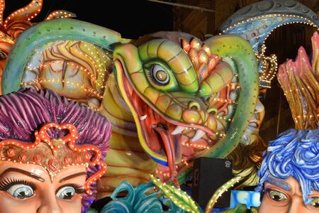 Acireale (CT), Italy - February 16, 2020: detail of a allegorical float depicting the head of a snake during the carnival parade along the streets of Acireale. Redakční