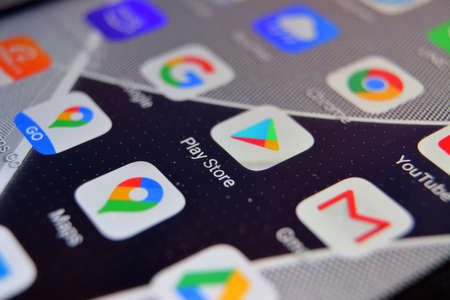 Valverde (CT), Italy - April 02, 2020: Close-up view of Google Play Store app on an Android smartphone, including other icons.