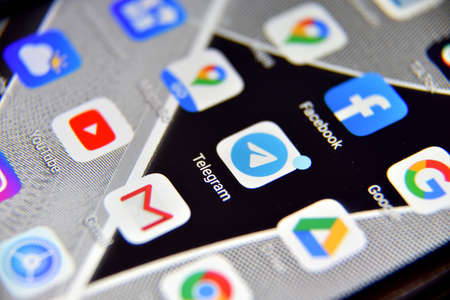Valverde (CT), Italy - April 04, 2020: Close-up view of Telegram icon app on an Android smartphone, including other icons.