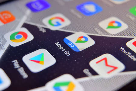 Valverde, Utalia - April 02, 2020: Close-up view of Google Maps Go app on an Android smartphone, including other icons.