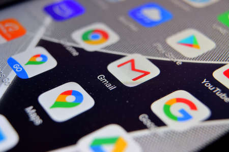 Valverde, Utalia - April 02, 2020: Close-up view of Google Gmail app on an Android smartphone, including other icons.