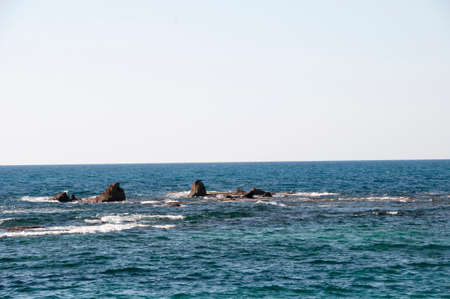 View of the sea and rocks on a warm spring day. Mediterranean Sea 版權商用圖片