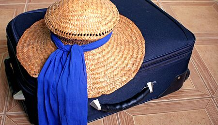 Straw hat and suitcase