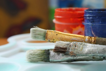 Color paints and brushes photo