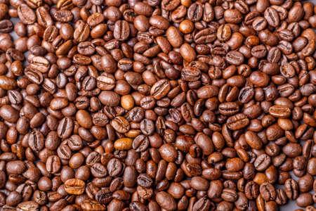 Macro shot of whole bean organic smooth medium dark roast coffee