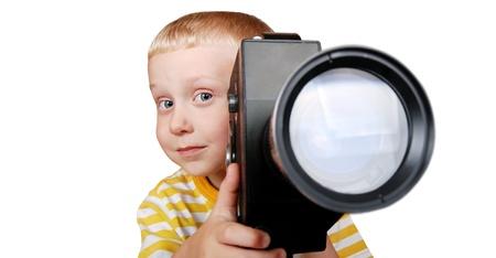 camara de cine: chico guapo con la vieja C�mara de cine en manos
