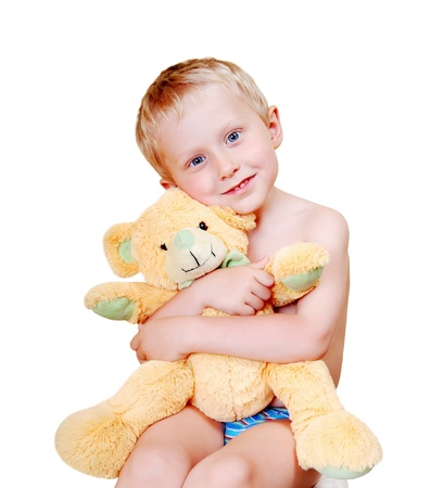 defenseless: Open smiling little boy portrait with his teddy bear love toy on white background