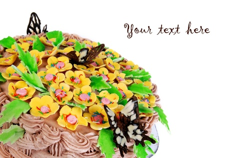 cake decorating: Big holiday cake decorating with cream, flowers and chocolate butterflies