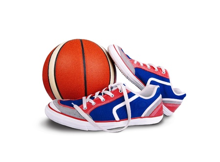 shoe strings: Bright colored sport shoes with basketball on white background Stock Photo