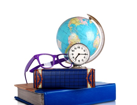 Education conceptual image with globe, glasses, alarm clock and books photo