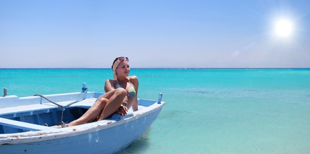 pleasure boat: Pretty young women on the old boat  in blue lagoon
