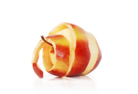 skin color: Red apple with peeled skin like a spiral on white background