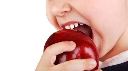 Close-up view childs healhty teeth and  ripe red apple photo